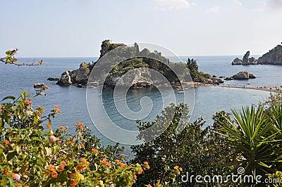 Coast of sicily with small island