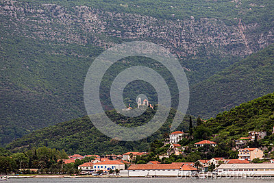 Coastal Buildings with Hilltop Church in Montenegro