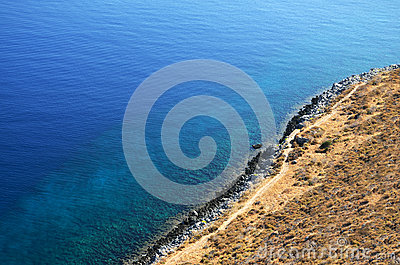 Coastal cliffs and blue waters
