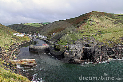 Coastal cliffs and cove jetty in Cornwall, UK