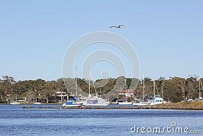 Coastal lake and boats scenery