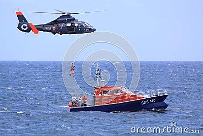 Coastguard rescue mission in progress Editorial Stock Image