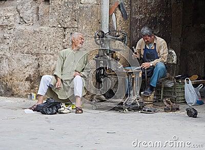 Cobbler outside Aleppo Citadel, Syria Editorial Image