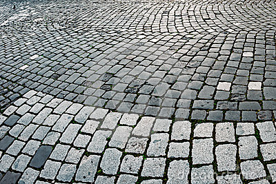 Cobblestone sidewalk made of cubic stones 8