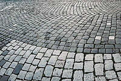 Cobblestone sidewalk made of cubic stones 8