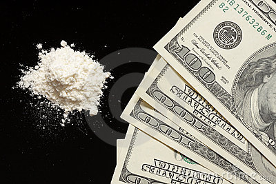Cocaine and hundreds on black background