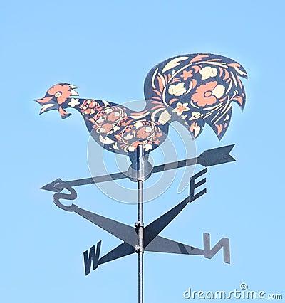Cock decorative on roof of arrow. Weather vane