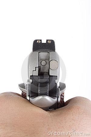 Cocked hand gun