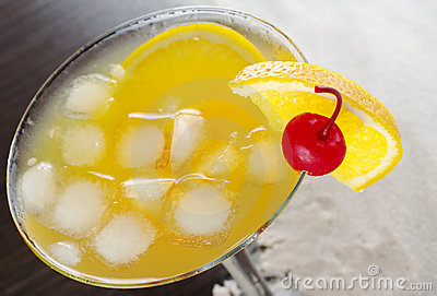 Cocktail with Cherry and Orange Slice on the Rim