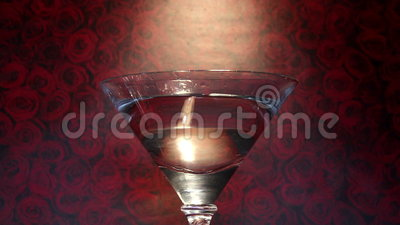 Cocktail drink strawberries roses background stock footage