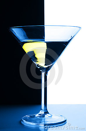 Cocktail glass over contrast background