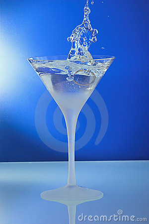 Cocktail glass with ring and standing mirror abstr