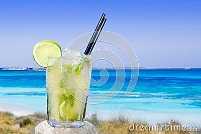 Cocktail mojito ice lemon straws in tropical beach