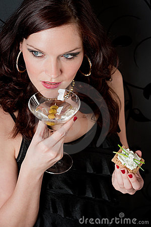 Cocktail party woman evening dress hold appetizer