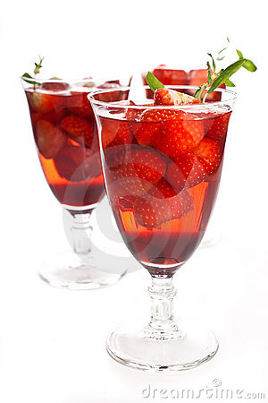 Cocktail with pink wine, liquor and a strawberry