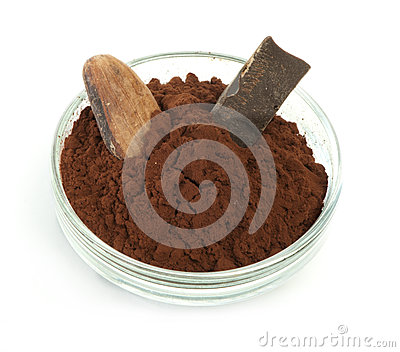 Cocoa bean, cocoa powder in bowls and piece of chocolate