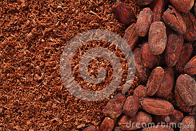 Cocoa beans and grated chocolate background