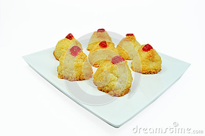 Coconut cakes with cherries