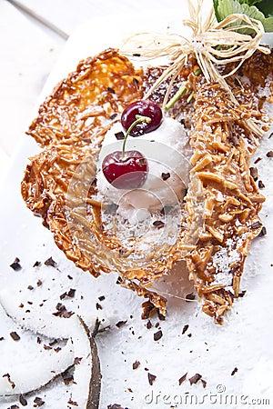 Coconut ice cream and cherry