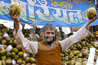 Coconut seller at a trade fair, India Editorial Photo