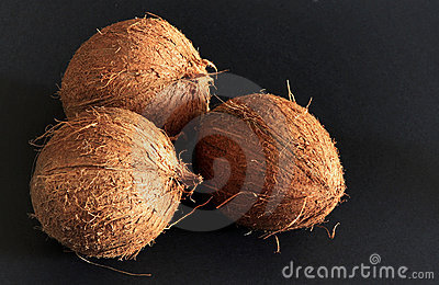 Coconuts on the black background