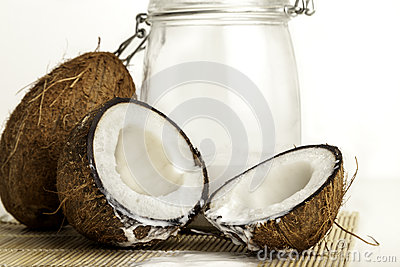 Coconuts with a jar of coconut milk