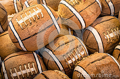 Coconuts painted as american football icons