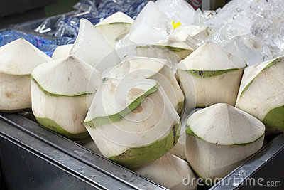 Coconuts peeled skin in market