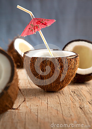 Coconuts on wooden background