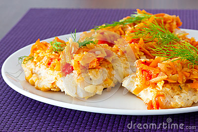 Cod with vegetables on the plate