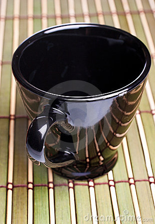 Coffe cup on bamboo mat
