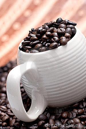 Coffee bean in a cup with ethnic mood.