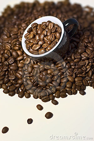 Coffee beans in the  black cup. Close up