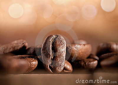Coffee beans on blurred background