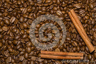 Coffee beans and cinnamon background