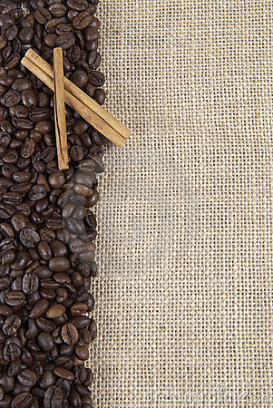 Coffee beans and cinnamon on a burlap.
