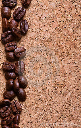 Coffee beans on a corkwood texture background