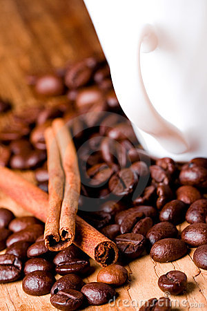 Coffee beans, cup and cinnamon