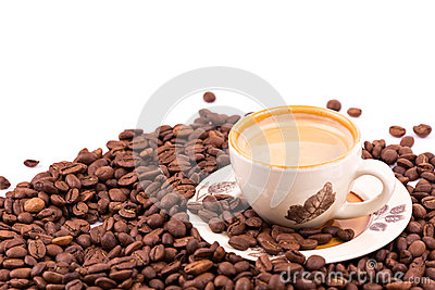 Coffee beans and cup of coffee background