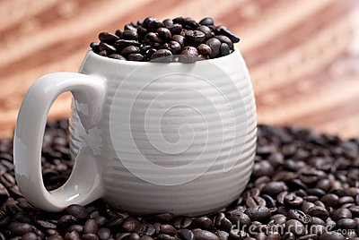 Coffee beans in a cup with ethnic mood