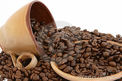 Coffee beans with cup and plate