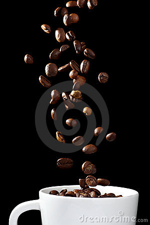 Coffee beans falling into cup