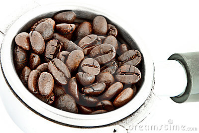 Coffee beans in filter holder