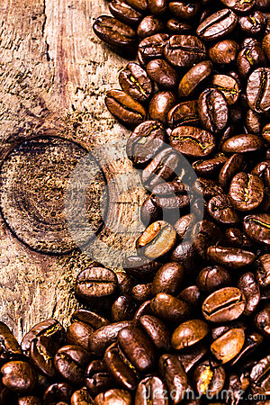 Coffee beans on grunge old wooden background. Coffee concept. To