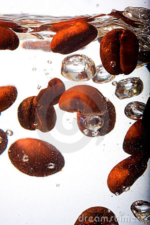 Free Coffee Beans In Water Royalty Free Stock Photography - 23112317