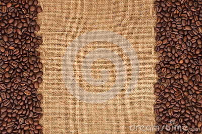 Coffee beans lying on sackcloth
