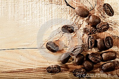 Coffee beans over wooden desk