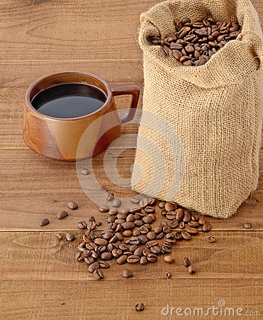 Coffee beans in sack and cup