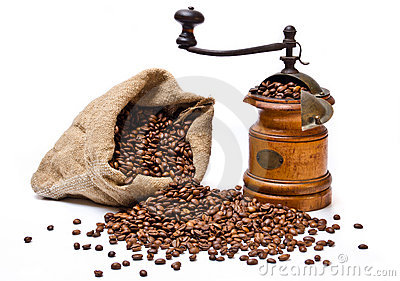 Coffee beans sack with wooden coffee grinder