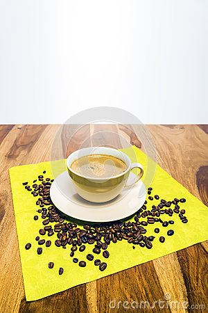 Coffee with beans on serviette
